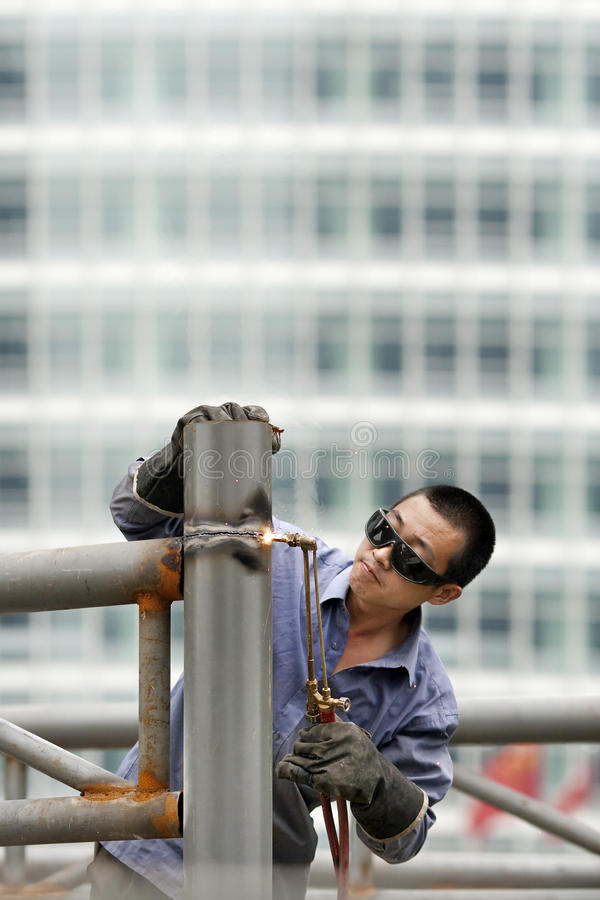 Welder busy on a construction site, beijing, China royalty free stock photo