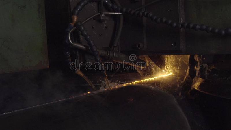 Welder complete with personal protective equipment is perform pipe welding in dark area using Automatic Welding System stock photos