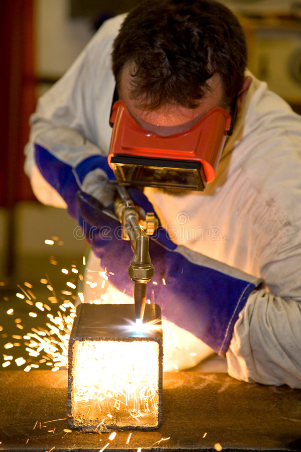 Welder Cutting With Flame Stock Image
