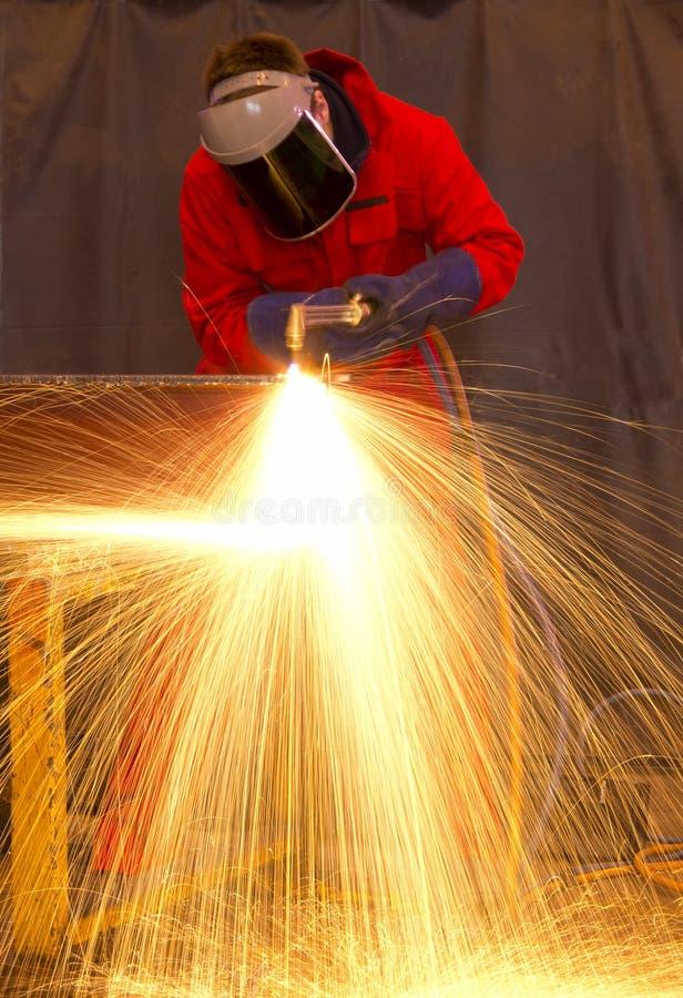 Free Welder In Red Creates Huge Orange Sparks Stock Images - 23460844