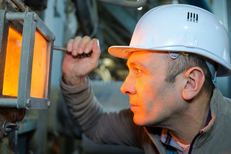 Welder man in factory stock images