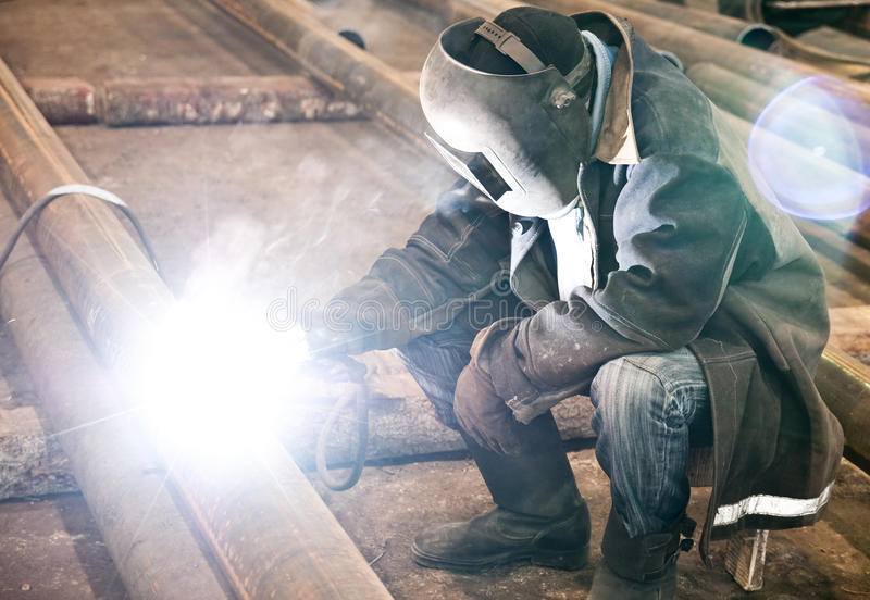 Welder in mask stock photos