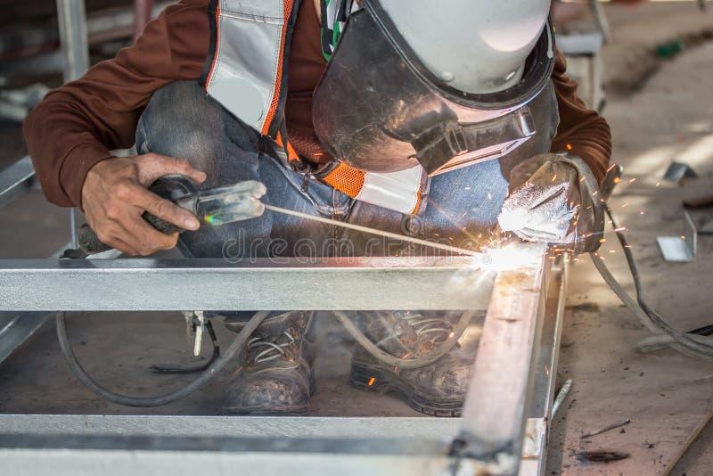 The welder in the operate,Employee welding U-steel using welder machine royalty free stock images