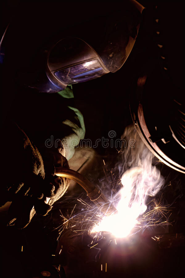 Welder welding stock photos