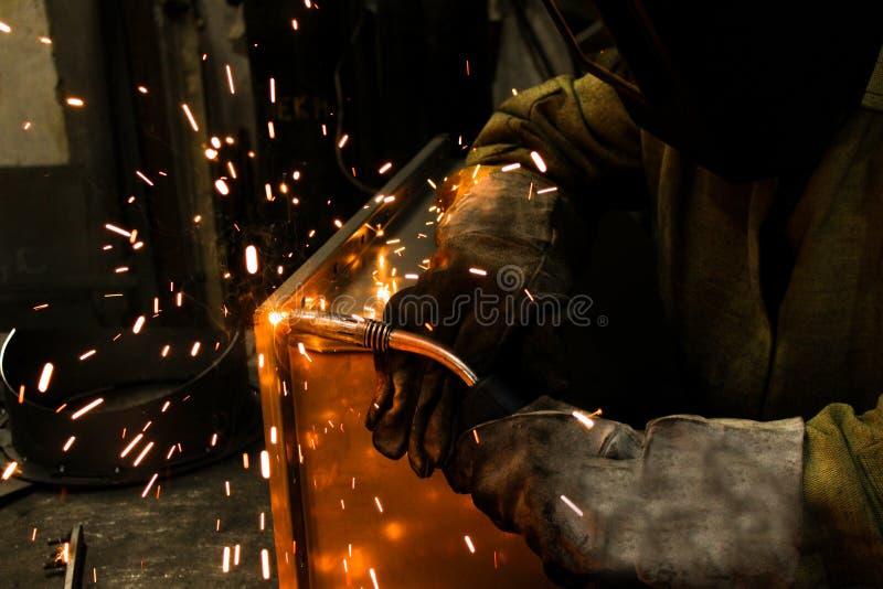 welder work, welding sparks, workshop production stock images