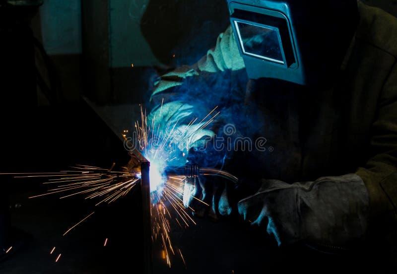 welder work, welding sparks, workshop production royalty free stock photo
