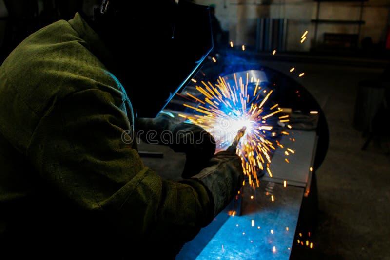 welder work, welding sparks, workshop production royalty free stock image