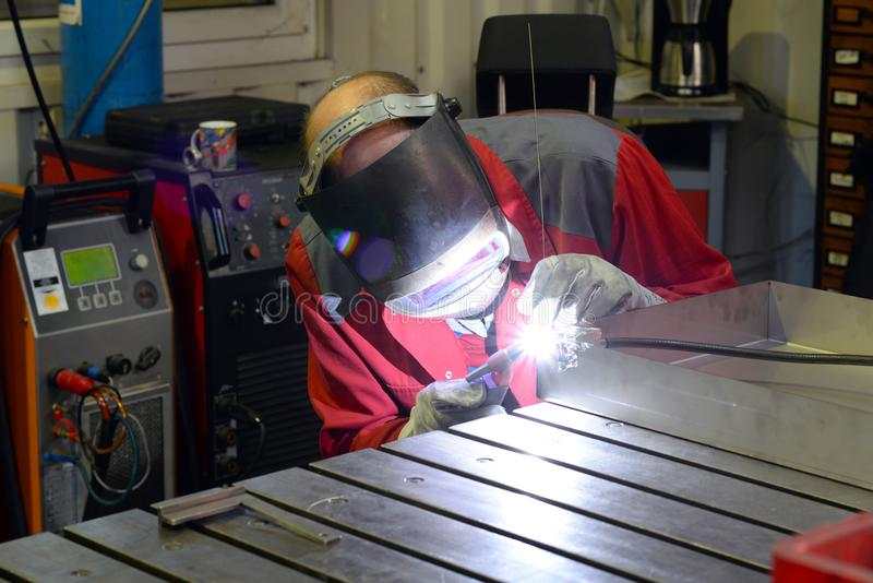 Welder works in the metall industry. Company - closeup portrait stock photo