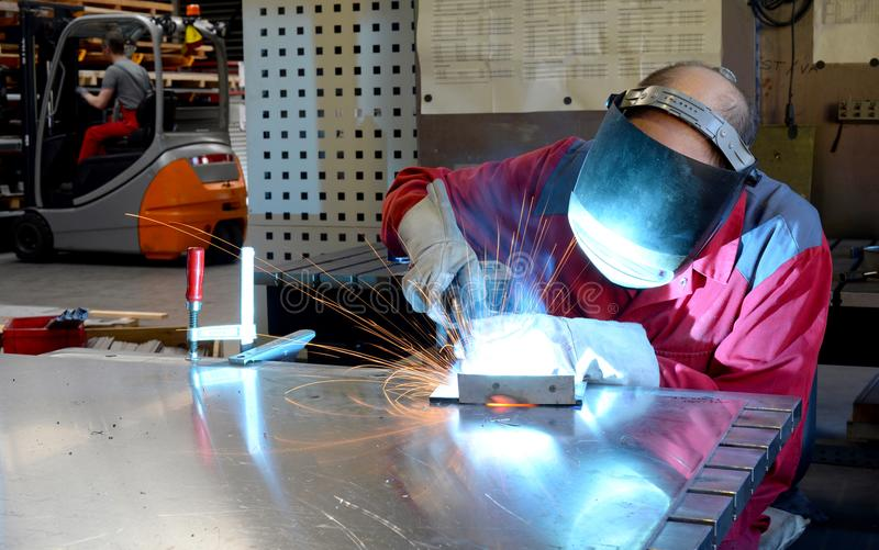 Welder works in the metall industry - portrait. Workman in the company royalty free stock photos