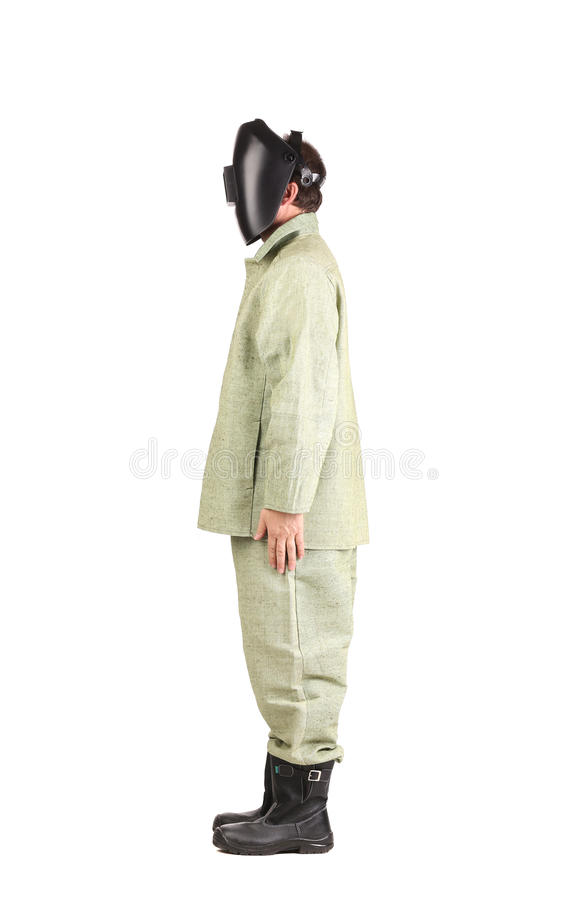 Welder in workwear suit with mask. stock photos