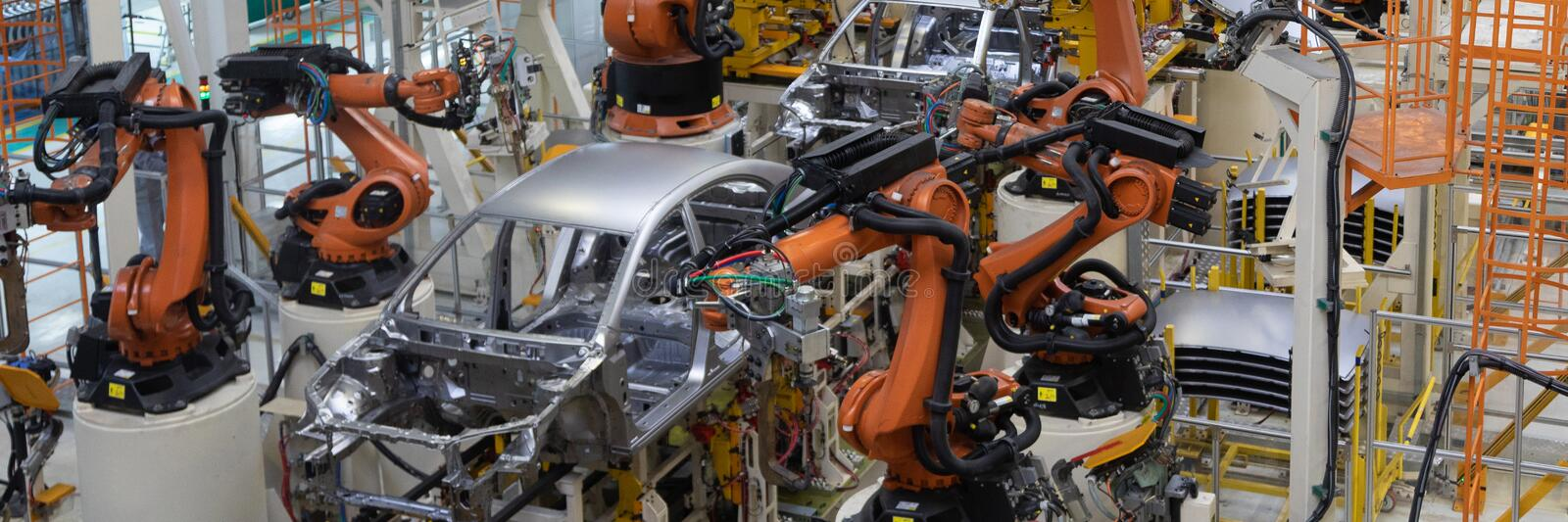 Welding of car body. Automotive production line. long format. Wide frame royalty free stock image