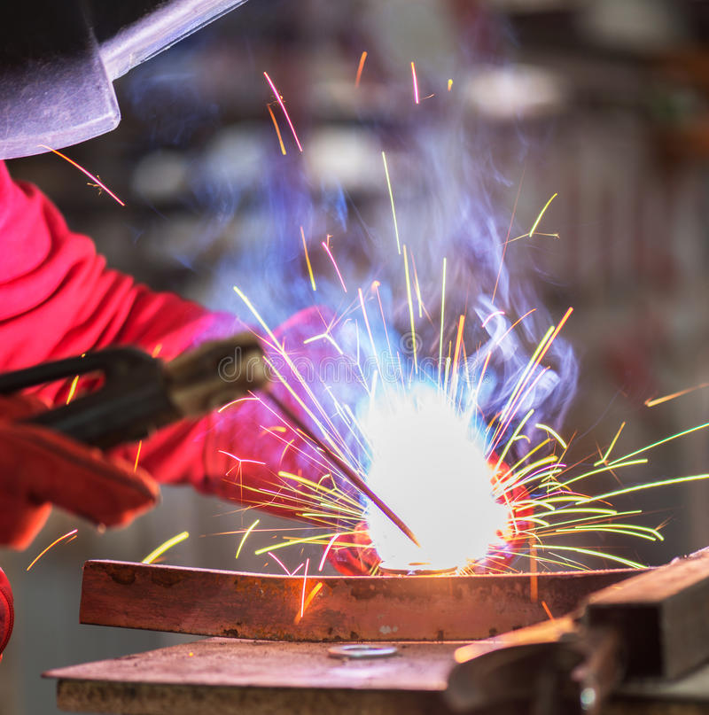 Welding closeup. Welding works of production facilities with the blurred background stock photo
