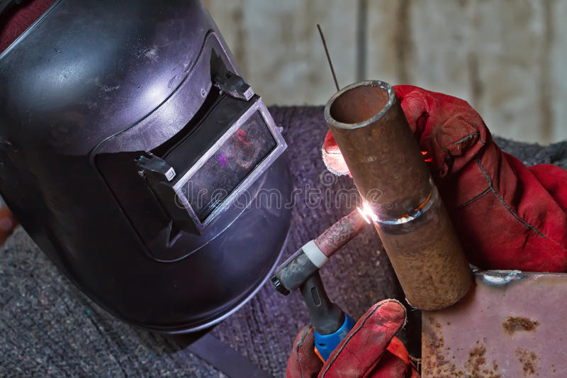 Welding control sample from a pipe of small diameter. For proficiency testing by the method of argon-arc welding royalty free stock photo