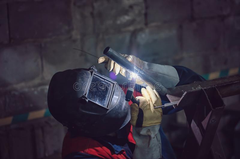Welding control sample from a pipe of small diameter. For proficiency testing by the method of argon-arc welding stock photography