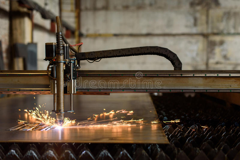 Welding device cutting plate on the heavy industry plant.  stock image