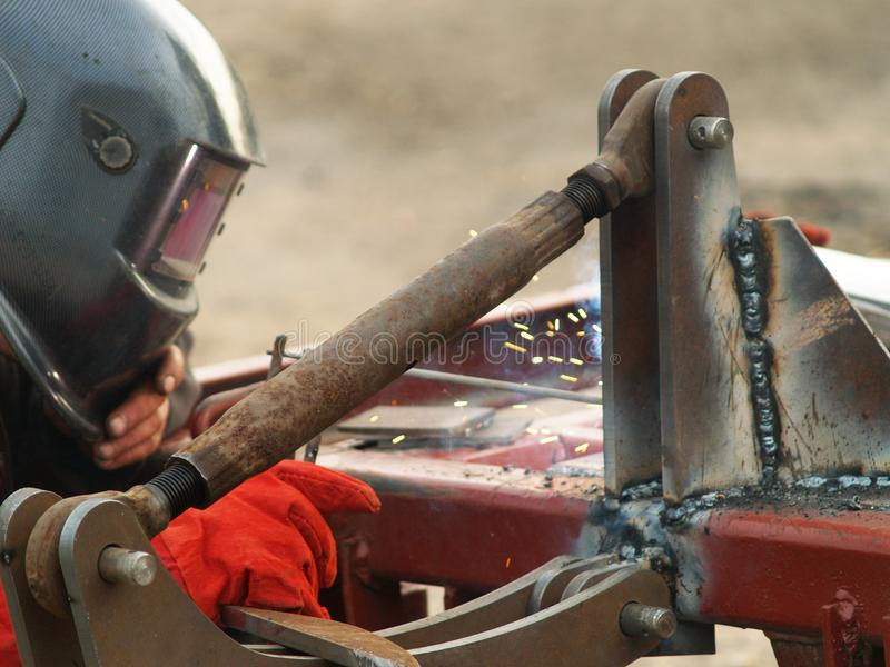 Welding with electrodes. Carrying out welding work with electric welding stock photo