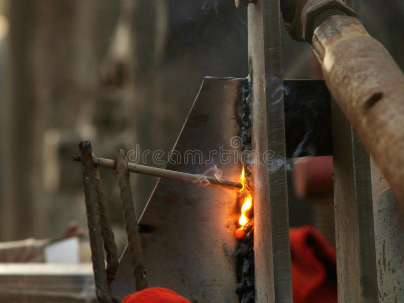 Welding with electrodes. Carrying out welding work with electric welding stock images