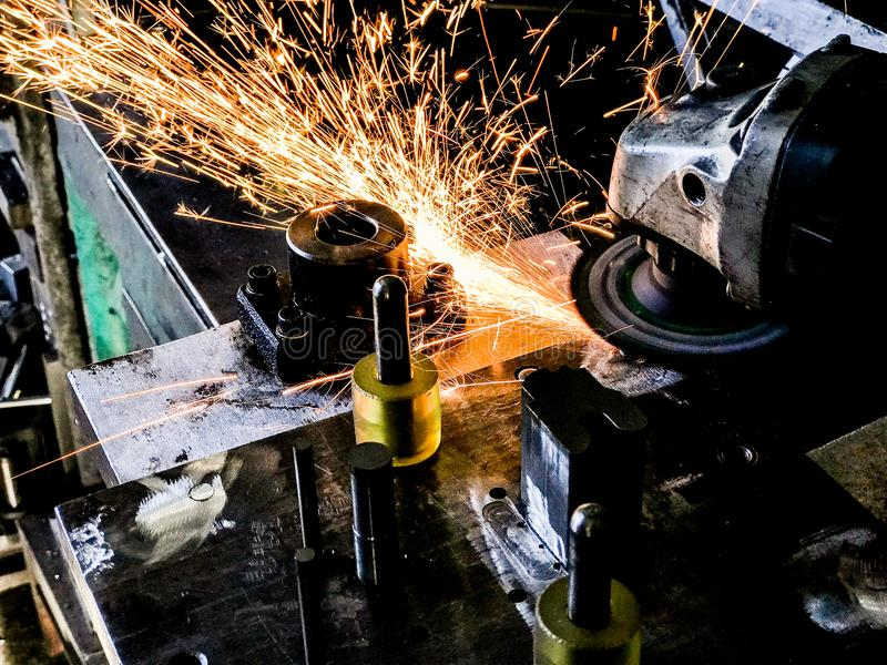 Welding and grinding within the manufacturing process Sparks and smoke. royalty free stock images