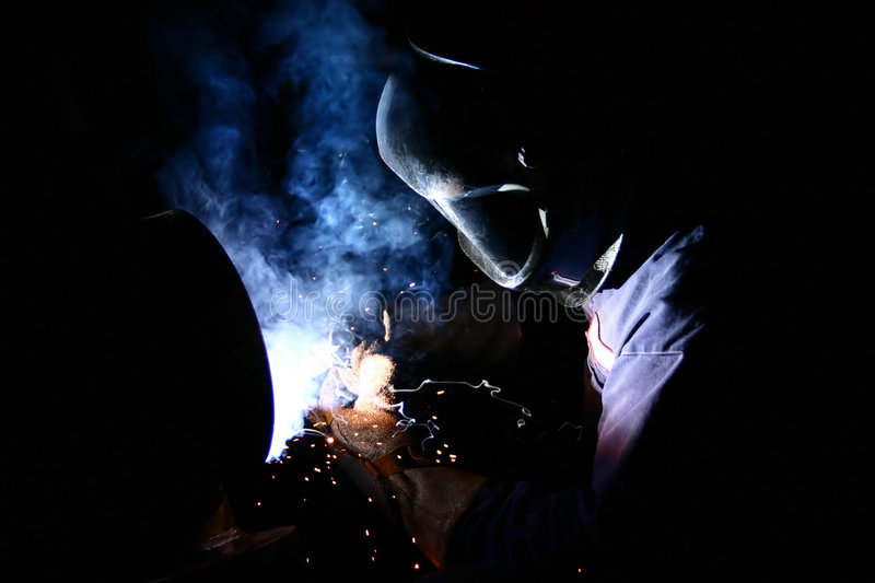 Welding Pipe. Electric arc welding of steel pipe royalty free stock image