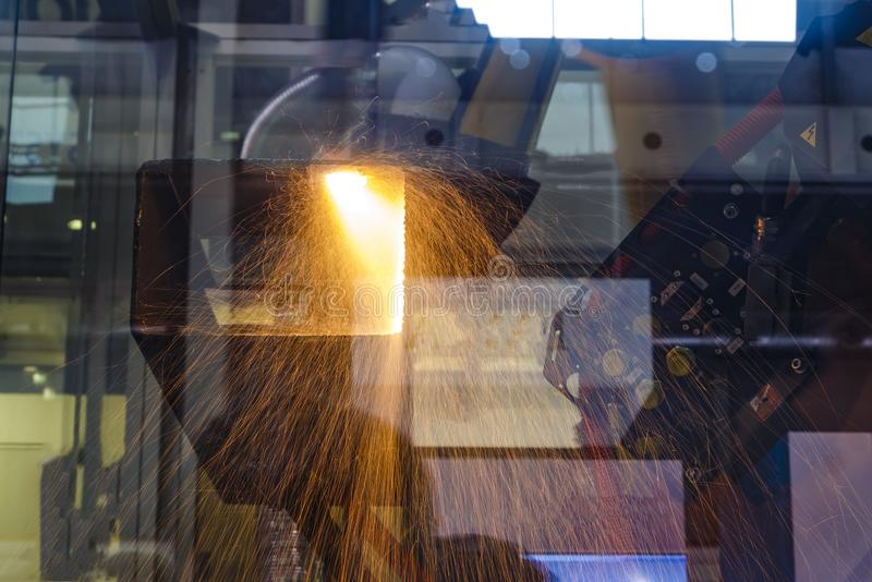 Welding process at robotic intelligent factory. Double exposure. Oxygen torch cuts steel sheet. Automotive industry with monitoring system software. Digital royalty free stock images