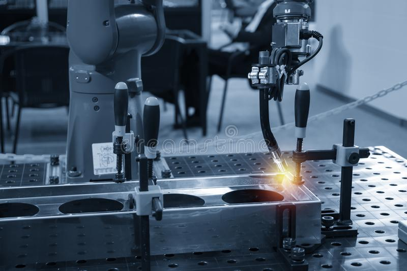 The welding robot machine for welding automotive part. royalty free stock photography