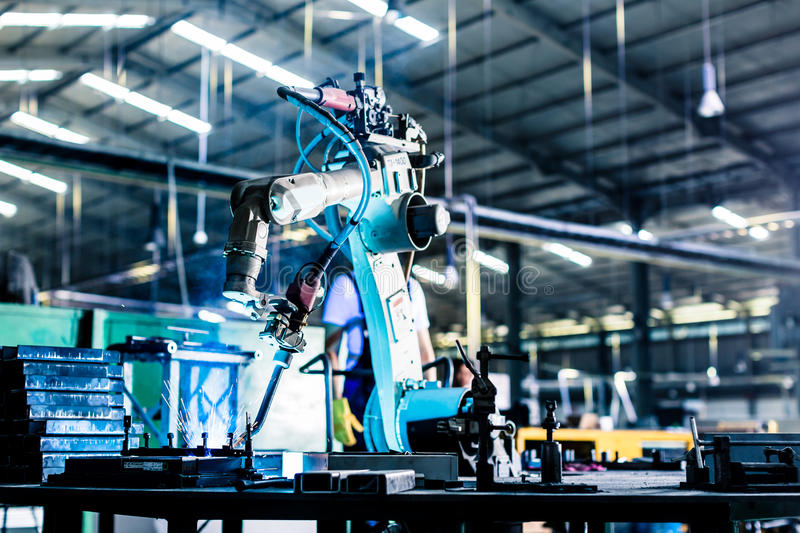 Welding robot in production plant or factory royalty free stock image