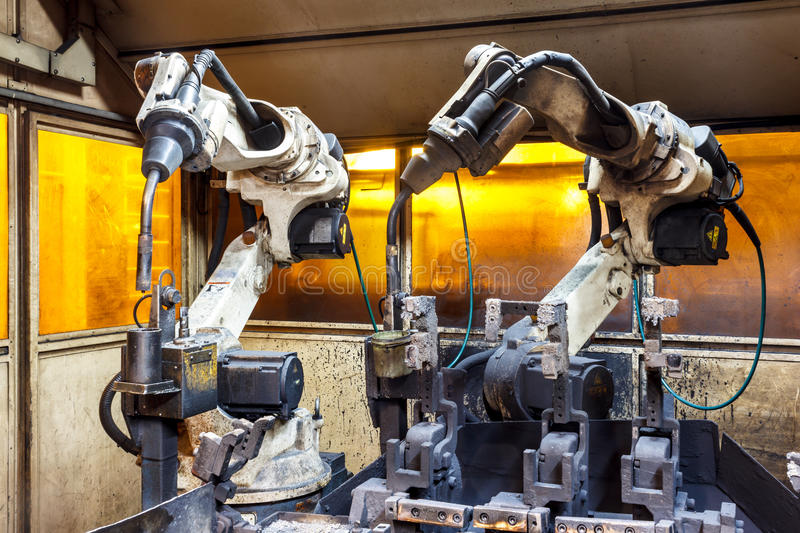 Welding robots movement in a car factory royalty free stock photography