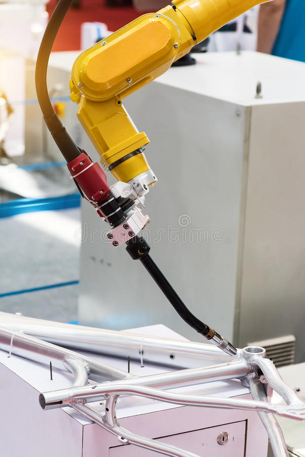 welding robots represent the movement in the automotive parts stock photos