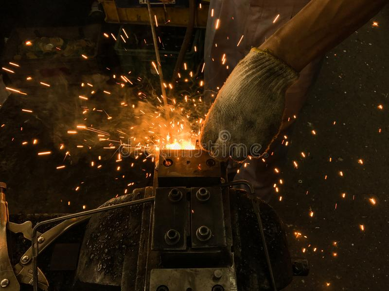 Welding of steel. Sparks and smoke from welding of steel royalty free stock photos