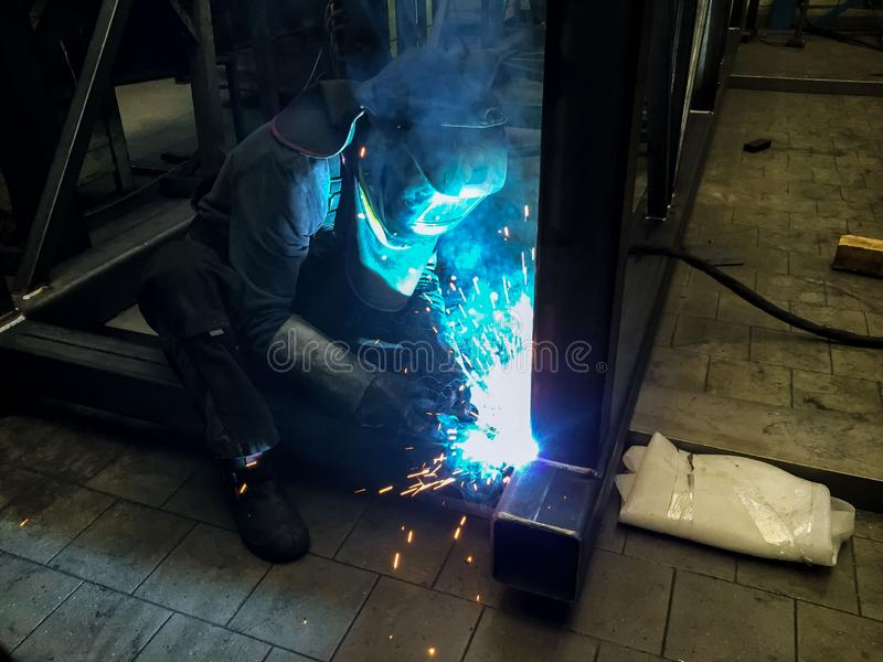 Welding of steel structures in the workshop by MIG technology. Welding of steel structures in the workshop by MIG technology royalty free stock photography