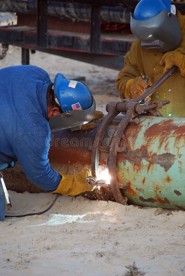 Download Welding two pipes together stock image. Image of construction - 7520379