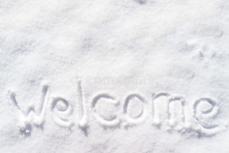 Welkom word written in the snow on a sunny day royalty free stock photo