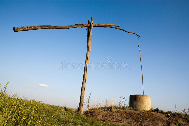 Download The well stock photo. Image of used, suspended, grass - 13675158