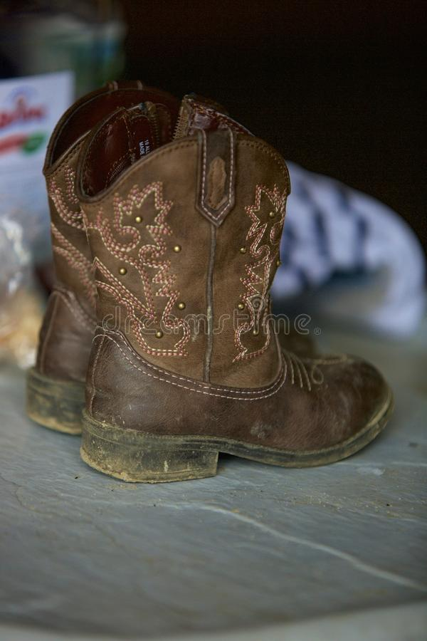 The Littlest Cowboy Boots stock photography