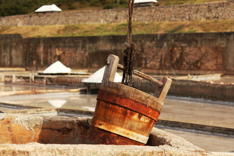 Well bucket. Close up of a bucket in a salt well of a tradicional salt mine located in Rio Maior - Portugal stock photo
