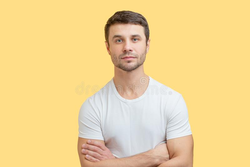 A well-built young man with serious face. stock photo