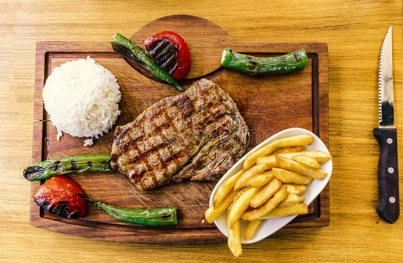 Well Cooked Beef with potato, rice and vegetables top view royalty free stock photos