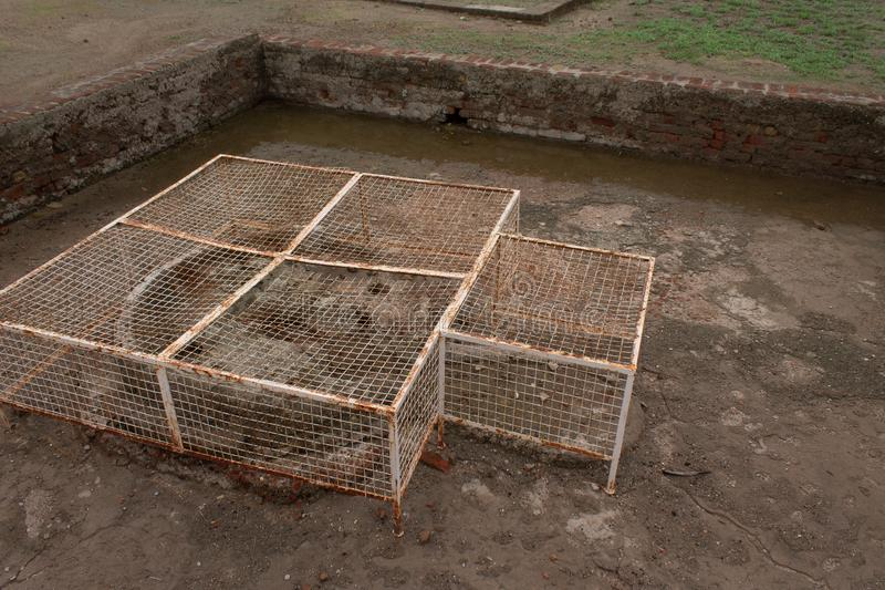 Well covered with grills at Lothal Harappan Site Ahmedabad Gujarat India. Well covered with grills at lothal  site, ancient, archaeology, archaeological royalty free stock photography