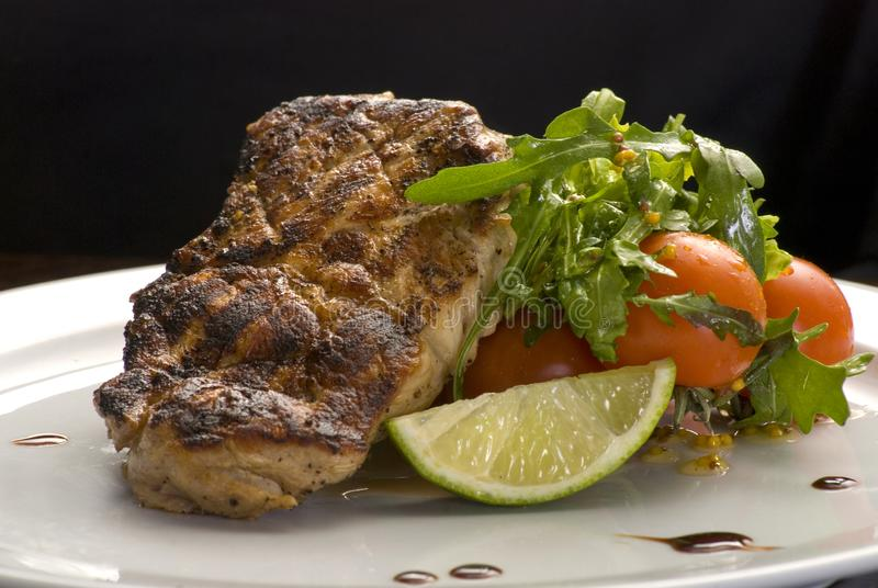 Well-done steak with suace and vagetables. Food photo for restaurant menu stock photos