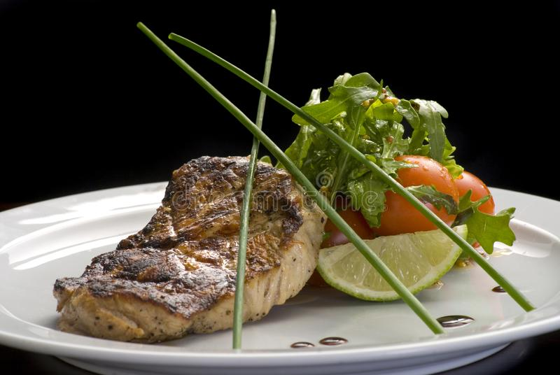 Well-done steak with suace and vagetables. Food photo for restaurant menu royalty free stock image