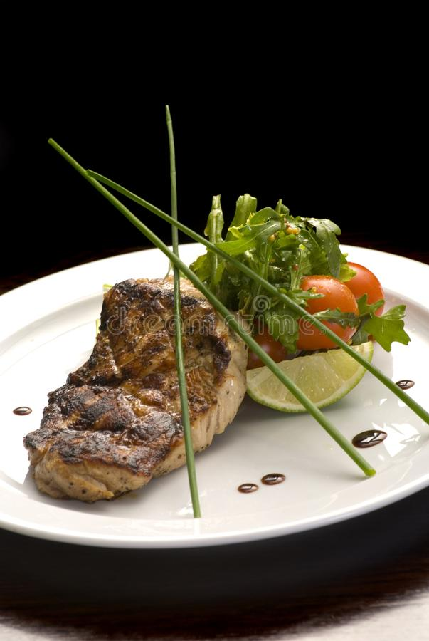 Well-done steak with suace and vagetables. Food photo for restaurant menu stock images
