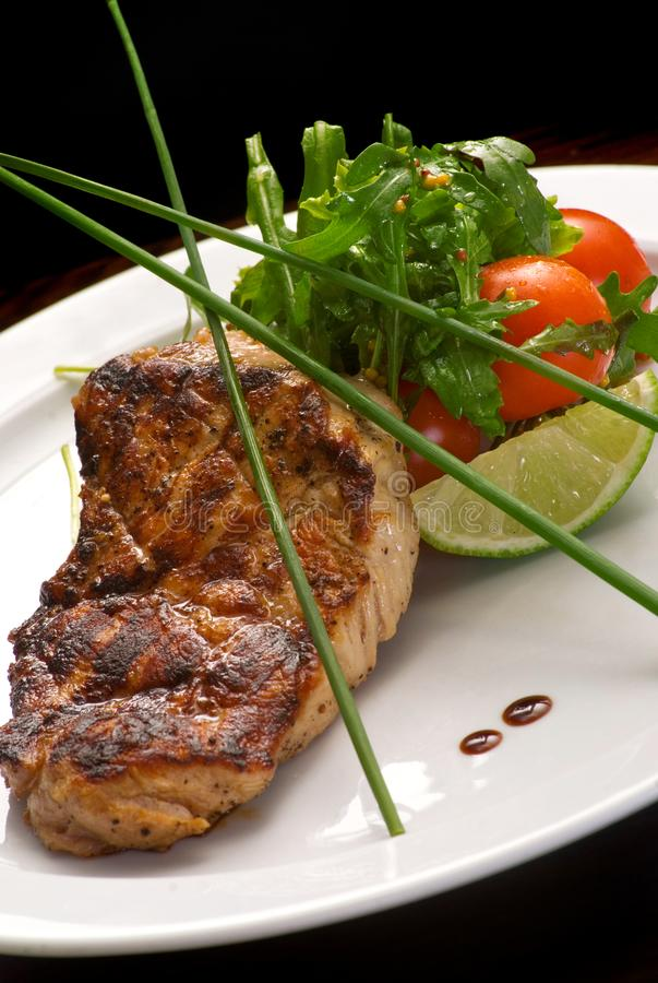 Well-done steak with suace and vagetables. Food photo for restaurant menu royalty free stock images