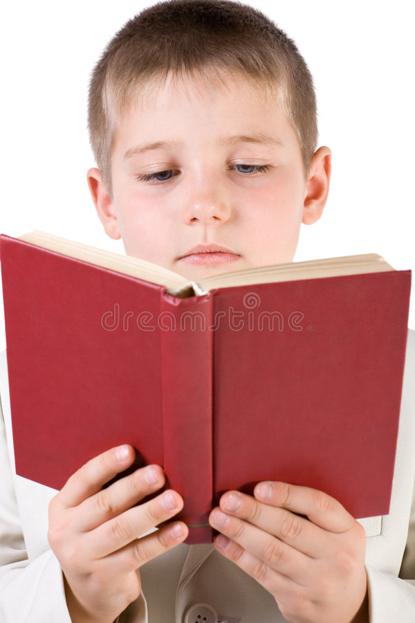 Well-dressed boy read book stock images