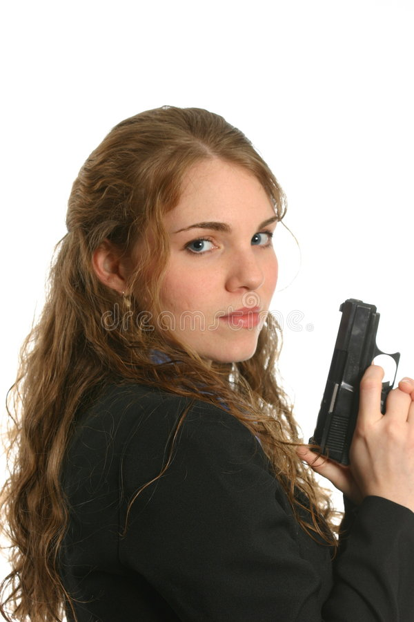 Well-dressed woman standing and holding a handgun stock photos