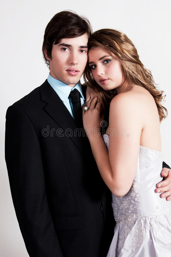 Well Dressed Young Couple Embracing