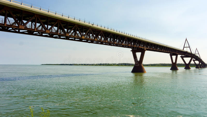 A well-engineered bridge over the mackenzie river. Bridge pillars designed to withstand ice damage in the northwest territories stock images