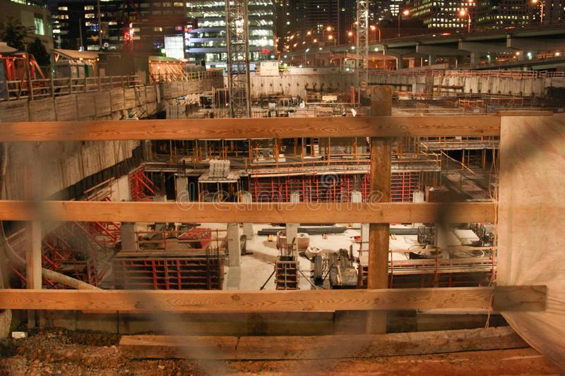 Well fenced construction site building the underground of high rise structure royalty free stock images