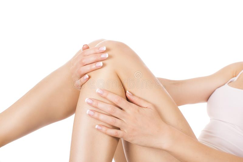 Well-groomed female legs after depilation isolated on white background. Skin care and hair removing concept stock photos