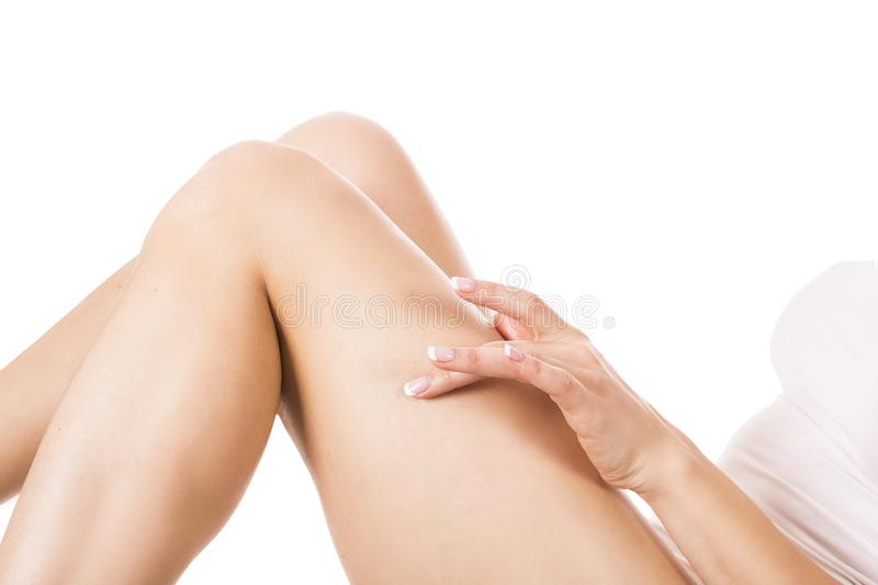 Well-groomed female legs after depilation isolated on white background royalty free stock image