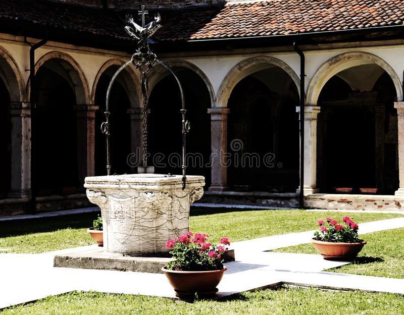 Well inside a cloister in the ancient Franciscan convent in Ital royalty free stock photo